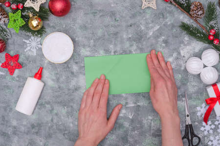 Christmas crafts - Christmas tree made of colored paper, step by step instructions. Step 8- fold the square in half