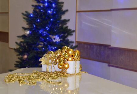 bright decorations for the Christmas holidays, for the Christmas tree, golden balls, close-up Stock Photo