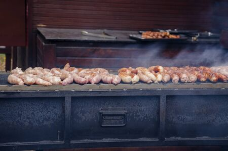 street food, meat tasty grilled sausages, cooking on charcoal in the outdoors