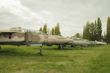 old non-flying military aircraft, stand on green grass in the open air Reklamní fotografie