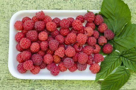 Useful vegetarian vitaminized food, ripe aromatic raspberry, close-up