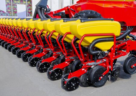 Bright colorful equipment for sowing seeds, machinery for the production of agricultural products 写真素材