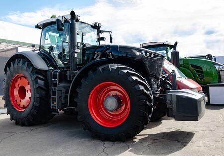 tractor with big wheels, machine for agricultural work and transportation of goods, close-up