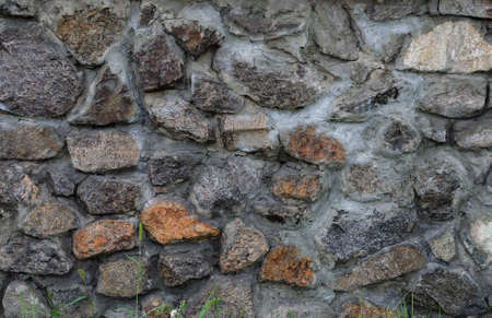 Textured masonry fence, fences with bright brown stone gravel close-up Reklamní fotografie
