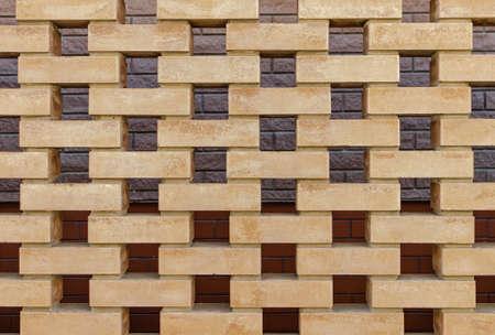 background with yellow beautiful bricks, masonry close-up Reklamní fotografie