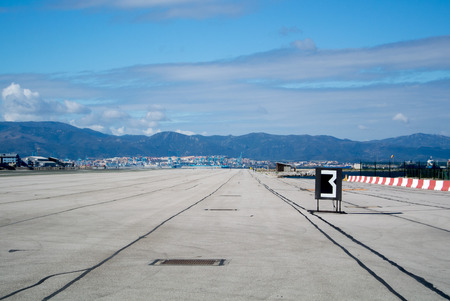 Gibraltar airport runway with mountains on background.