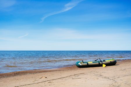 An inflatable boat at early spring morning on the coast of Baltic sea near St. Petersburg, Russia. Stock Photo