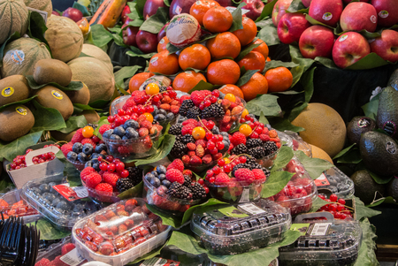 BARCELONA, SPAIN - FEBRUARY 12, 2014: Fruits and berries at La Boqueria food market at the center of Barcelona, Spain. Editorial