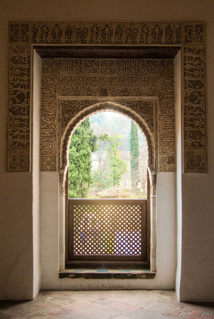 GRANADA, SPAIN - FEBRUARY 10, 2015: An archway with a view to a garden at Generalife Gardens of Alhambra palace, Granada, Andalusia, Spain. Editorial