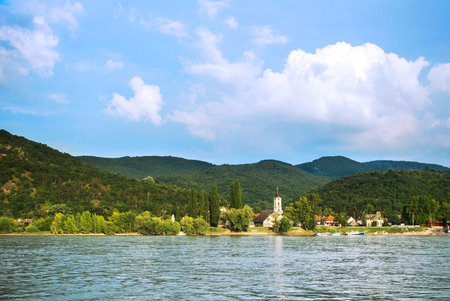 A view to a church at Visegrad, a small town at Hungary near Budapes, from Danube. Stock Photo