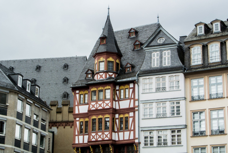 roemer: FRANKFURT, GERMANY - JUNE 4, 2017: Traditional german decorated houses at the Frankfurt Old town square on cloudy rainy summer day.