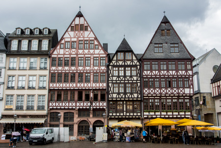 FRANKFURT, GERMANY - JUNE 4, 2017: Traditional german decorated houses at the Frankfurt Old town square on cloudy rainy summer day.
