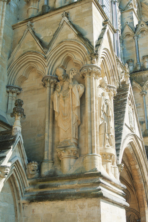 LONDON, ENGLAND - AUGUST 02, 2013: Sculptures on the exterior of Salisbury Cathedral in Wiltshire. Example of early english gothic architecture.