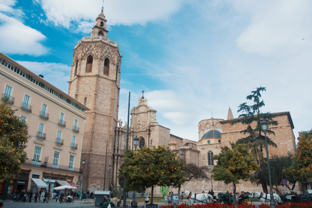 VALENCIA, SPAIN - FEBRUARY 3, 2016: A square in front of Miguelete tower and Metropolitan Cathedral - Basilica of the Assumption of Our Lady of Valencia (Saint Mary's Cathedral or Valencia).