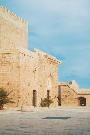 A view to entrance of medieval moorish fortress Alcazaba in Almeria and beautiful blue sky on the background, Andalusia, Spain. Stock Photo