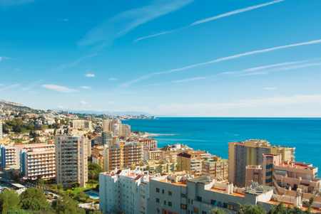 A view to Fuengirola town and its surroundings, hotels, resorts and beaches of Mediterranean sea on sunny day, Andalusia, Spain.