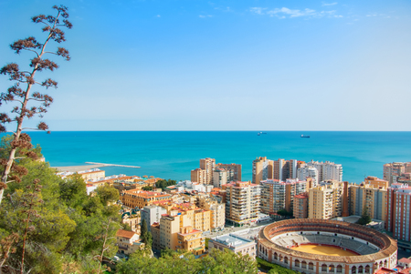 MALAGA, SPAIN - FEBRUARY 16, 2014: Beautiful panoramic view Malaga city, a bullring, hotels and Mediterrain sea seascape from the Gibralfaro Castle, Andalusia, Spain, on sunny evening. Editorial