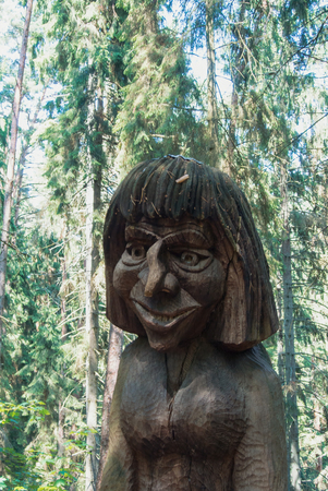 JUODKRANTE, LITHUANIA - JULY 16, 2015: Old wooden sculpture statue portrait, Witch Hill park, Juodkrante, Curinian spit, Lithuania. Editorial