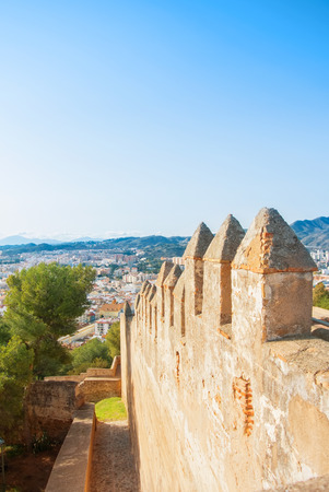Old mediewal walls of the Gibralfaro Castle of Malaga, Andalusia, Spain, on sunny evening. Editorial