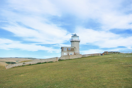 Belle Tout Lighthouse on summer cloudy day, Seven Sisters country park, Eastblurne, East Sussex, England, UK.