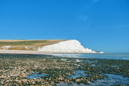Beautiful famous coastline of The Seven Sister Chalk Cliffs natural park, East Sussex, England, United Kingdom.