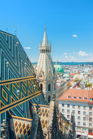 VIENNA, AUSTRIA - JULY 29, 2016: Aerial panoramic view of the rooftop of Vienna Cathedral from the north tower of St. Stephen's Cathedral, Austria. 新闻类图片