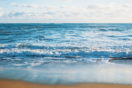 Beautiful seascape of sea ocean waves with white foam in the evening, abstract background of holiday by the sea. Stock Photo