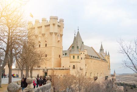 SEGOVIA, SPAIN - FEBRUARY 11, 2017: Old historical center of Segovia, Alcazar of Segovia (Segovia Fortress) and tourists walkind on sunny winter morning. Toned film effect background instagram. Editöryel