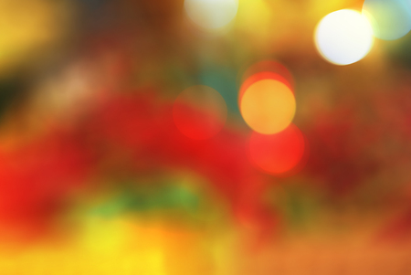 Bright red yellow orange green abstract beautiful colorful bokeh blurred lights texture background. 免版税图像