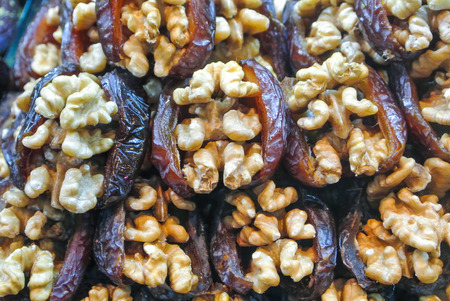 Close up macro of traditional turkish sweets of prune and walnut for sale on open street city market in Stuttgart, Germany. Stock fotó