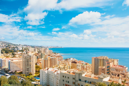 Panoramic aerial top view to Fuengirola town and its surroundings, hotels, resorts, buildings and beaches of Mediterranean sea on sunny day, Andalusia, Spain. Winter relax vacation by the sea concept.