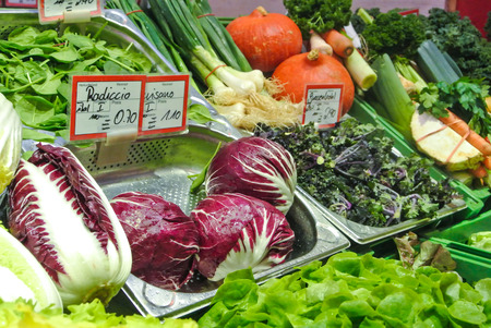 STUTTGART, GERMANY - DECEMBER 28, 2017: Variety assortment diverse of fresh healthy tasty vegetables, pumpkin, red cabbage, green herb, radish for sale on open street city market in Stuttgart, Germany