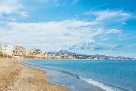 Panoramic aerial top view to Malaga city and La Malagueta beach, hotels, resorts, buildings and wavy Mediterranean sea on sunny day, Andalusia, Spain. Winter relax vacation by the sea concept. Stock fotó - 92930369