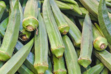 Close up macro of fresh green okra for sale on open street city market in Stuttgart, Germany.