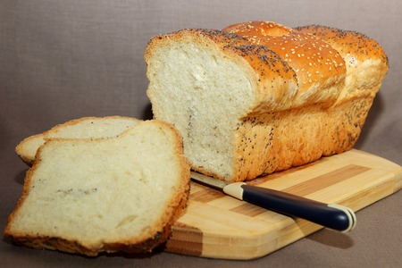 Freshly baked bread, cut into slices photo