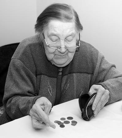 believes: Elderly grandmother believes penny in your wallet Stock Photo