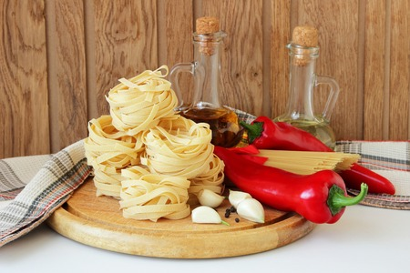 oil bottle: Pasta, peppers, spices and oil bottle Stock Photo
