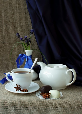 forest tea: Bouquet of spring flowers forest, tea set and sweets Stock Photo