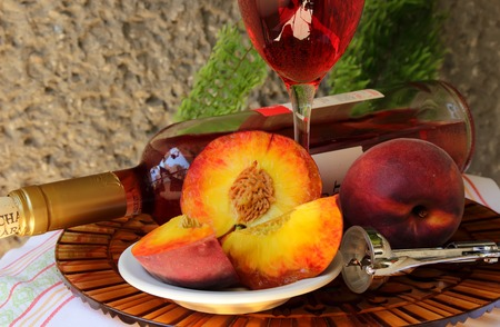 Still life with bottle,  glass of wine and peaches   photo
