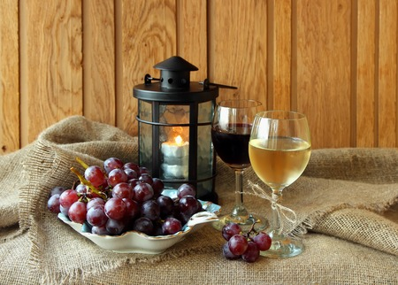 Two glasses of wine and grapes photo