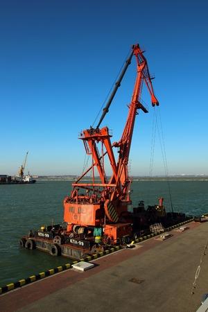 Odessa, Ukraine,October 27, 2014,Big crane standing near the shore in the seaport city of Odessa