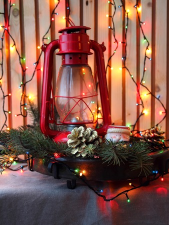 Centrepiece: Still life with lantern and Christmas tree branches