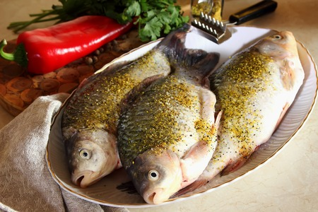 gutted: Gutted fish, sprinkled with spices and ready-to-cook Stock Photo