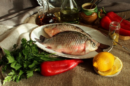 Still life with carp and vegetables photo