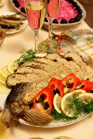 stuffed fish: Stuffed fish on a platter, decorated with vegetables