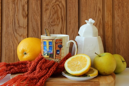 warming therapy: Warming cup of tea, tied with a scarf and fruit