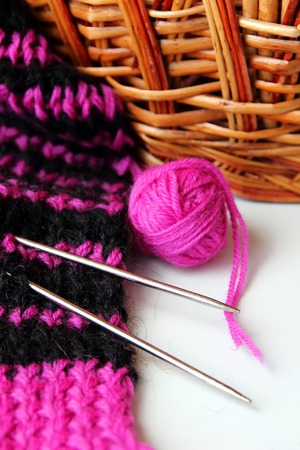 acrylic yarn: Knit scarf with stripes and a ball of yarn Stock Photo