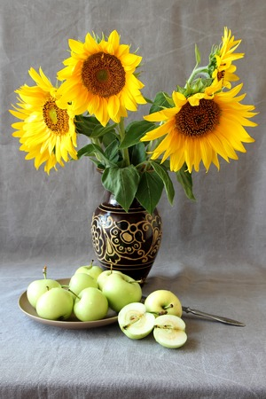 Still Life With Apples And Sunflowers Stock Photo