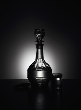 decanter: Decanter with vodka and hot pepper. Stock Photo