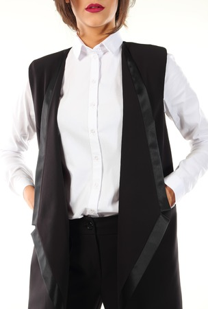 pantsuit: Modern black pantsuit with a white blouse on a model.